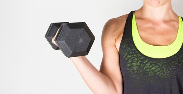 Woman lifting heavy dumbbell