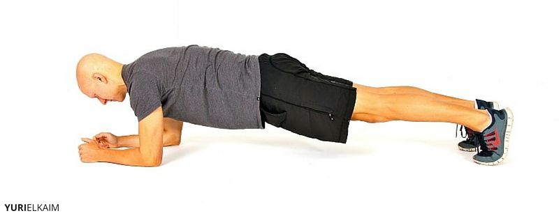 Yuri Elkaim doing a plank