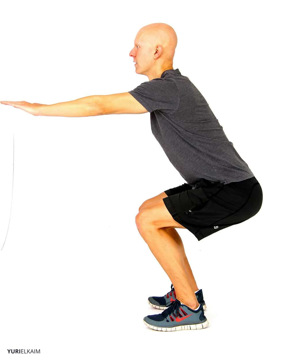 Core Strength Exercises - Squat with Extended Arms