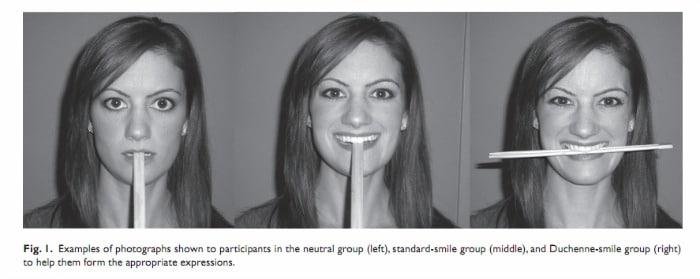 Woman holding chopsticks between her teeth