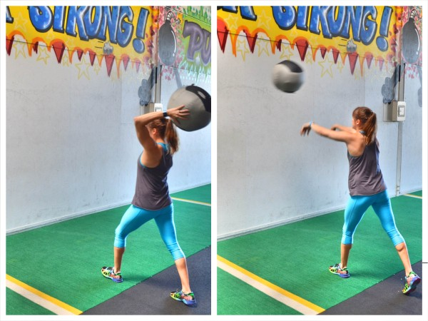 Woman soccer throwing a medicine ball