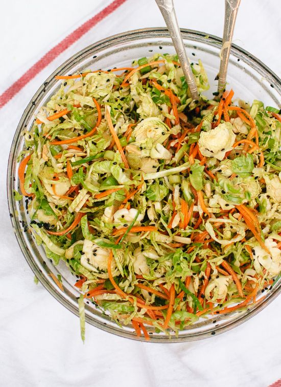 Asian Brussels Sprouts Slaw with Almonds and Carrots via Cookie + Kate