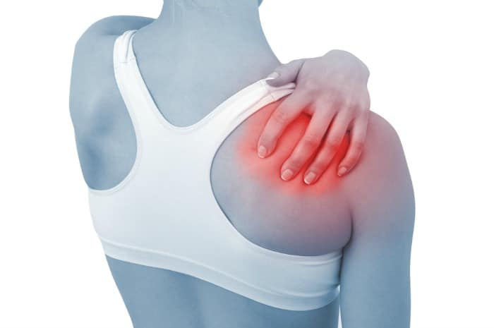 woman rubbing an inflamed shoulder