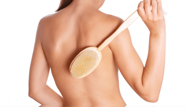 woman dry brushing her back
